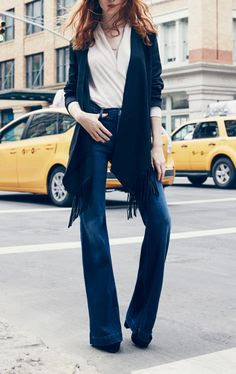 Must have these tailored flared jeans by 7 For All Mankind. They are comfortable and made from the best material: Thick without being too heavy and the length is perfect. Even women with long legs can wear these with heels and they'll still be long enough!