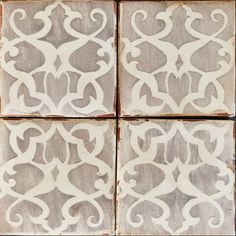These hand painted terracotta tiles take cues from Baltic and Balkan aesthetics and reflect the whimsical patterns of ancestry and heritage.