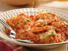 Slow Cooker Cheesy Ravioli Casserole (use any 2 non chunky spaghetti sauces, 1 8 oz. tomato sauce, 3/4 c. dry red wine,1 tsp. basil in place of ital. seas., cheese ravioli, parmesan cheese &  no fresh parsley.