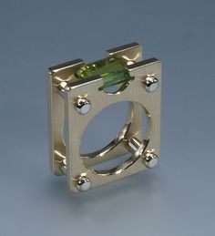 Ring | John M Ryan. 14k yellow gold, 14k white gold, peridot
