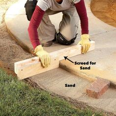 Make an attractive border for a concrete walkway or patio using brick pavers set on a bed of gravel and sand.