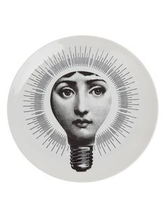 Bring distinctive design to any room of the home with this Tema e Variazioni wall plate from Fornasetti. Depicting the face of Piero Fornasetti's favourite muse, Lina Cavalieri in a lightbulb, it is b Piero Fornasetti, Fornasetti Wallpaper, Everyday Objects, Throw Pillow Cases, Woman Face, Plates On Wall, Coaster Set, Les Oeuvres, Illustration