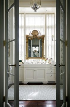bathroom in natural light with glass doors on the interior to keep it open, if not exactly private..