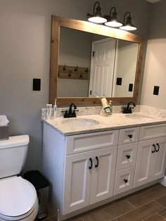 17 Fresh & Inspiring Bathroom Mirror Ideas to Shake Up Your Morning Lipstick Routine Hall bathroom update Benjamin Moore Coventry gray paint. Bathroom Mirror Makeover, Bathroom Mirror Design, Bathroom Lighting Design, Hall Bathroom, Bathroom Vanities, Bathroom Ideas, Bathroom Updates, Framing Bathroom Mirrors, Bathroom Renovations