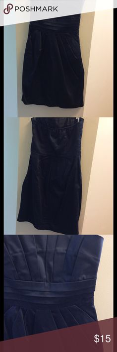 Navy strapless dress - like new! Gorgeous envy dress worn only 1x to a wedding rehearsal dinner. Can be dressed up or great for date night. Has pockets that blend into the pleats and side hidden zipper. Snap Dresses Mini