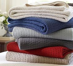 Add a red blanket at the bottom of our bed to replace the grey one for the Holidays.  Pick-Stitch Quilt  Sham #potterybarn