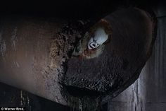 Iconic character: 'Pennywise takes the shape of your worst fear,' the movie's director Andrés Muschietti said as the new images were released Monday