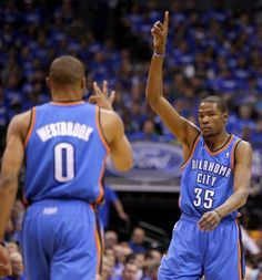Representin' OKC! Oklahoma City's Kevin Durant (35) and Russell Westbrook (0) celebrate after a basket during Game 3 of the first round in the NBA playoffs between the Oklahoma City Thunder and the Dallas Mavericks at American Airlines Center in Dallas, Thursday, May 3, 2012. Photo by Bryan Terry, The Oklahoman