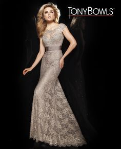 Fall 2014 Collection- Lace gown with slight cap sleeves, features an illusion bateau over sweetheart neckline, beaded lace appliqu�s, sheer back, all over sequin accents, ruched waistband and soft a-line skirt.� Perfect for young mother of the bride/groom or any formal affair.Sizes: 2 � 20