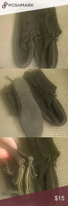 Minnetonka leather moccasins Minnetonka black leather moccasins.   Zipper in the back. Minnetonka Shoes Moccasins