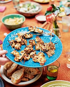 Marinated in yogurt, honey and mustard then grilled to charred, smoky perfection – serve these chicken skewers as a light starter or summer canapé.