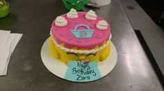 An eight inch Shopkins cake.