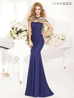 Craving something out of the ordinary? Try the Tarik Ediz 92413 evening dress. You are sure to adore the way the cross hatched straps made of natural stone clusters drape the back and criss cross the neckline falling off the shoulder for a dramatically sexy look.