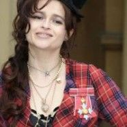 Helena Bonham Carter stays true to her adorably wacky fashion character even when getting a CBE from the Queen.  Love her!