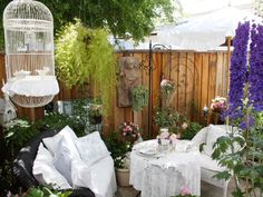 If you always find yourself torn between the outdoors and fine elegance, here's a place for you. The lace table linens and antique birdcage might just make you want to pull out the tea set and evening gloves for a night of entertaining guests in the great outdoors. Photo courtesy of My Romantic Home