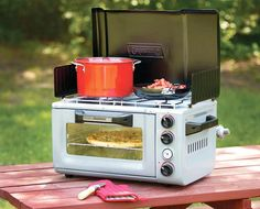 Coleman Outdoor Portable Oven/Stove  Just because you're out on a camping trip doesn't mean you have to dine like a caveman or Cub Scout. There are plenty of alternatives to campfire-ash-crusted wieners and beans from the can. Coleman's Outdoor Portable Oven is a propane powered two-burner stove that also has an oven large enough to cook a 12-inch pizza. Just the thing for keeping it gourmet in the great outdoors