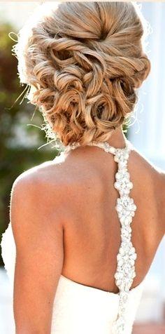Bride's loose chignon wedding hairstyle