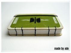 A little notebook with playing cards for covers.  Nice tutorial.