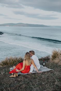 **This whole shoot is just gorgeous** that red dress! Tasmanian House Rules stars Sean and Ella are engaged. Location: South Arm, Tasmania. MU by The makeup ambulance. Photographed by Tasmanian based destination wedding photographer Cherrie Eisemann (Acoma Studio).