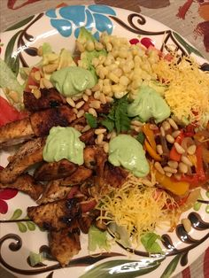 Cilantro Lime Chicken on my salad with fajita sweet peppers and grilled onion, cheese, tomato, avocado, corn and pine nuts. Topped with homemade avocado & cilantro dressing. It's what's for dinner.