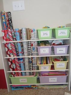 Gift wrap paper, and bins for: scissors & tape,  stationary & sharpies, bows, ribbons, tissue paper, tags & embellishments, and gift bags