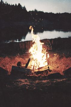 campfires near a lake.