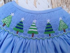 This beautiful smocked dress would be a great alternative to the traditional red Christmas dress! Description from ebay.com. I searched for this on bing.com/images