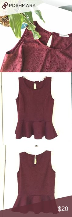 🎉HP🎉 Maroon Peplum Top This maroon peplum top is perfect for any kind of day! It comes in a size medium and it's 96% polyester and 4% spandex. The pit to pit measurement is 17 inches and the length of the top is 22.5 inches. It has been gently used and is still in good condition! Let me know if you're interested! Ginger G Tops Blouses