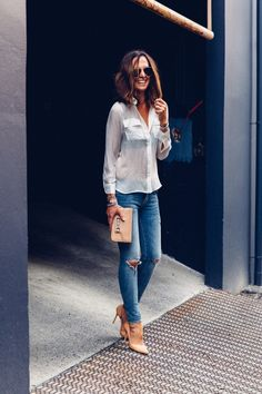 White Blouse + Ripped Denim + Nude Pumps and Clutch