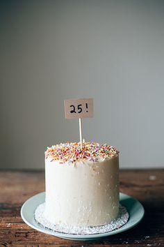 chocolate cake with halva filling, tahini frosting, and a crap ton of sprinkles because... — molly yeh
