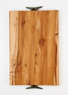 Love this! This oversized cutting board is made from a block of reclaimed wood, handrubbed with olive oil, and finished with aged steel boat cleat handles for long-lasting quality. From Rodale's.