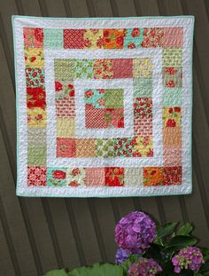 A Taste of Marmalade is a baby quilt, quite simple in construction, yet a delightful little finish. The pattern is Storytime Squares , desig...