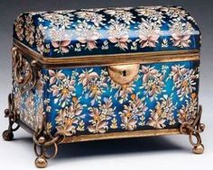 Year: 1893 - 2005 A fine Moser type glass jewelry casket with a domed hinged lid in a wonderful blue glass, having allover enameled flower decoration. The box has side swing handles and four wire and ball feet.