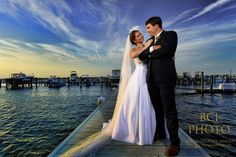 Dynamic lighting makes the skies pop in this shot of the bride and groom following their wedding ceremony at Harbour Ridge Yacht and Country Club in Pt St Lucie Florida.