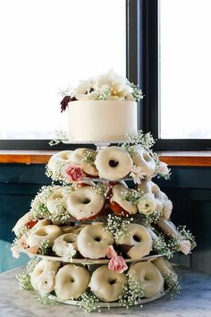 Try a donut cake as an alternative to the traditional wedding cake! And there's still a layer for you to stick in the freezer for your anniversary. Doughnut Wedding Cake, Wedding Donuts, Wedding Desserts, Wedding Cakes, Wedding Decorations, Rustic Wedding, Our Wedding, Dream Wedding, Wedding Ideas