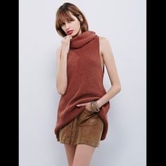 Free People turtleneck Chunky knit sleeveless sweater featuring a cowl neck and dropped armholes. High, open slit in back. 126L975  RETIL: $108 SIZE: XS  ❤I have over 300 new with tag Free People items for sale! I love to offer bundle discounts!  ❤No trades. love the item but not the price? Submit an offer! Free People Tops Tunics