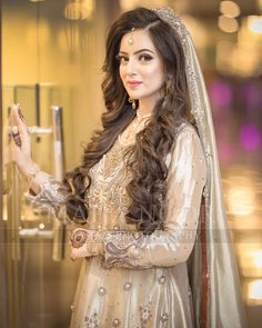 Brides / Dulhan from pakistan and india mostly on their Valima Nikah or celeberate this ceremony before their wedding day by wearing these bridal dresses. Most of these contain colors of Golden, White, Offwhite with minimum amount of makeup.