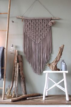 This unique piece is made by hand using tshirtyarn made of recycled fabric out of the fashion industry. The used wood is a treebranche found on the North Seacoast of the Netherlands and its surrounded dunes/forest area. The branch is cleaned and sanded where needed. --------- MACRAMÉ