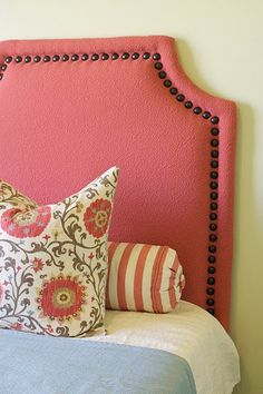 Love the shape and the nailheads for a DIY headboard.@Lacy Magby here is a headboard you could make.