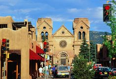 An awesome array of historic buildings line the Plaza in Santa Fe, including the Palace of the Governors, the country's oldest continually occupied public building; the Loretto Chapel, with a spiral staircase, and St. Francis Cathedral, the only non-adobe structure on the square. Beyond the fine architecture, the plaza has retained its role as a traditional market, with Native American artisans peddling their wares both in the open on the verandah of the Palace of the Governors and indoors…