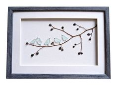 Unique birds wall art made of genuine sea glass in beautiful variety of blue color. A great gift for new home house warming gift or for any bird lover. Suitable for nursery, bedroom or living room decor.  Made of genuine sea glass, pebbles and dry twig found on the beaches near Varna, Black Sea coast. Framed with a white matting and custom made wooden frame in vintage style /a grey color with a slight blue tint/. The frame is hand painted and distressed. The artwork is not cover in glass in…