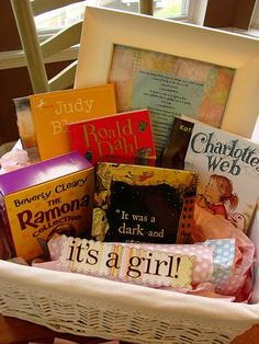 A starter library gift basket for the new baby:) Great idea.