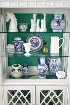 Emily Clark takes a twist on a classic in this China cabinet makeover. She used Alexandrite (SW0060) paint from the new HGTV HOME by Sherwin-Williams collection, and added layers of lovely in blue and white styling.