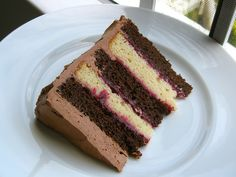 chocolate-vanilla layer cake with raspberry filling and chocolate buttercream