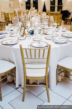 Wedding table decor ideas - gold, candles, white, elegant, winter, chairs {Bozena Voytko Photography}