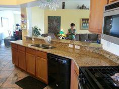 Giallo/Golden St Cecelia Granite, oak cabinets and eased edge.