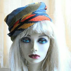 """1960s Mr John Classic New York Paris Hat Mr John was a millinery designer for socialites and celebrities of the 50's and 60's. This 1960s mod hat is very funky for its day. The velvet fabric has wide stripes in orange,  gold,  olive green and gray blue. There is  black ribbon trim around the folded up brim, with a small bow on one side.    20"""" around the inside ribbon 9 3/4"""" high Vintage Accessories Hats"""