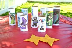 Use paper stars to knock down NInjago baddies, taped onto toilet paper rolls