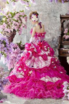 Stella de Libero  Fuschia / hot pink wedding gown featuring multi-textured skirt.