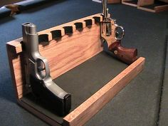 Auction:9102024 This handcrafted OAK Handgun/Pistol Rack Holds 8 guns. Is complete with a clear protective finish and neoprene rubber gun rests. I accept all